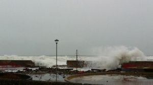Waves overtopping the sea wall at Lossiemouth during the December 2012 storm, causing severe structural damage and flooding a park.