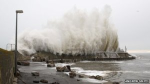 Waves overtopping the harbour wall at Portmahomack during December 2012 storm.